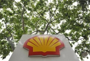 A logo is seen under a canopy of trees at a Shell gas station in central London July 29, 2010. Reuters/Toby Melville
