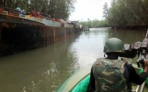 Nigeria's JTF confronting  illegal crude oil bunkering in Yenagoa, Niger Delta Nigeria 26 May 2013