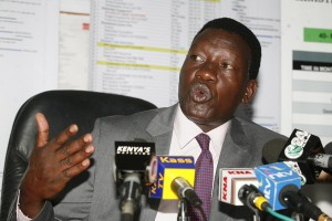 Kenyan Energy Secretary Davis Chirchir addressing journalists at his Nyayo House office on January 27, 2014 after naming the successful firms who had placed bids for Coal and Petroleum power plants.