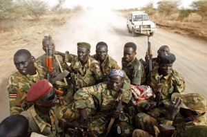 Soldiers from South Sudan's former rebel army, the SPLA, patrol in the streets of Malakal, in the Upper Nile state, South Sudan.
