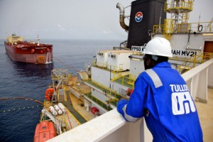 Tullow Oil said it found oil and gas-condensate at a key well off the coast of Mauritania.
