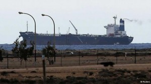 Eastern Libya separatists loading a North Korean-flagged tanker docked at the Es Sider export terminal in Ras Lanuf on Saturday.  Photo: Reuters