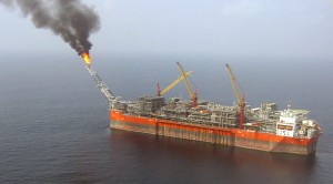 An aerial view taken on February 5, 2008 120 kms off the coast of Nigeria, south of Lagos, shows the FPSO Bonga (Floating, Production, Storage and Offloading). Far from the Niger Delta and its MEND militants, the 305-meter long ship pumps night and day 225,000 bbls of petrol a day and 150 million cubic feet of gas. AFP Photo/ Jacques Lhuillery.