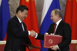 Russian President Vladimir Putin and China's President Xi Jinping at a ceremony in Shanghai to sign a long-awaited historic $400 billion gas deal. Photo: Reuters