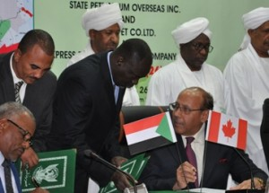 A representative from the State Oil Company Canada Ltd signs the exploration and production sharing agreement in Khartoum on Sunday, while vice-president Hasabo Abdel Rahma and investment minister Mustafa Osman Ismail look on (Photo courtesy of the ministry of petroleum)