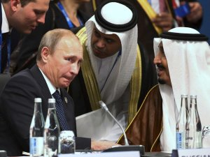 President of Russia Vladimir Putin (L) and Crown Prince Salman bin Abdulaziz Al Saud (R) of Saudi Arabia talk through their interpreters during a plenary session at the G20 leaders summit in Brisbane November 15, 2014.