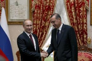 Turkey's President Recep Tayyip Erdogan (right) shakes hands with Russia's President Vladimir Putin.