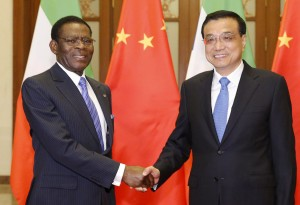 Equatorial Guinea's President Teodoro Obiang Nguema Mbasogo (L) shakes hands with Chinese Premier Li Keqiang before a meeting at the Great Hall of the People in Beijing, China, April 29, 2015.