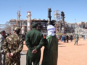 Algerian soldiers and officials stand in front of the gas plant in In Amenas after the bloody hostage standoff, during a visit organized for news media on Jan 31, 2013. (AP)