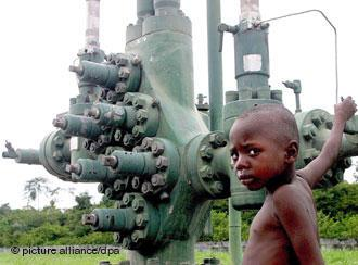 A Nigerian boy plays close to an oil well in Olomoro village in Isoko area of the delta region.