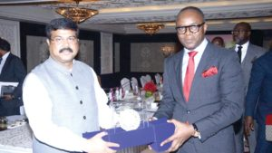 Nigeria Minister of State for Petroleum Resources, Emmanuel Ibe Kachikwu receiving a souvenir from the India oil Minister Dharmendra Pradhan